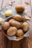 Basket of crude potatoes on a gray napkin Royalty Free Stock Image