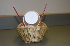 Basket with cups Stock Photography