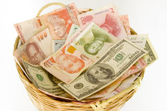 Basket of currencies Stock Images