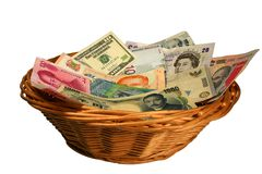 Basket of Currencies. Basket Of different banknotes Royalty Free Stock Photography