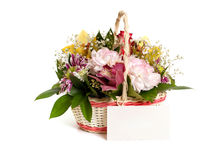 A basket of cut flowers with a greeting card Stock Images
