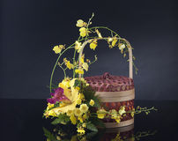 Basket decorated with bouquet of flowers Royalty Free Stock Images