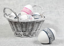 Basket with Easter Eggs and One Egg Close Stock Images