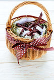 Basket with decorated eggs on the boards Stock Photography