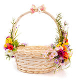 Basket decorated with flowers Royalty Free Stock Images