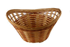 Basket. Decorative basket, woven from straw and wood chips brown color (isolated object stock photography