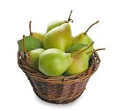 Basket with delicious ripe pears on background. Basket with delicious ripe pears on white background Royalty Free Stock Image