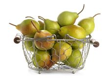 Basket with delicious ripe pears on background. Basket with delicious ripe pears on white background Royalty Free Stock Photos