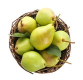 Basket with delicious ripe pears on background. Basket with delicious ripe pears on white background Stock Photo
