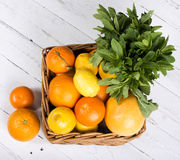 Basket with different fruits in season Royalty Free Stock Images
