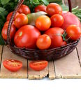 Basket with different types of tomatoes Royalty Free Stock Photography