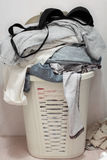 Basket dirty laundry in the bathroom Stock Photo