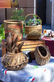 Basket display. A variety of baskets displayed on table at outdoor market Royalty Free Stock Images