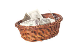 Basket with dollars Stock Photos