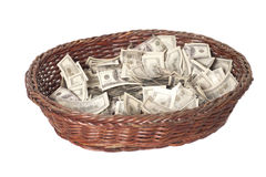Basket with dollars isolated on white Stock Photography