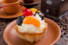 Basket of dough with cream and cherry Royalty Free Stock Photos