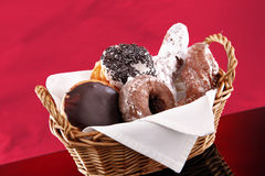 Basket of doughnuts royalty free stock photography