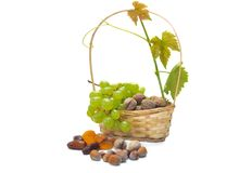 Basket of dried fruits and grapes Royalty Free Stock Photos