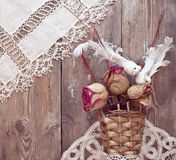 Basket with dried roses and white birds. Little basket with dried roses and white birds Royalty Free Stock Image