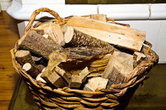 A basket with dry firewood Stock Images