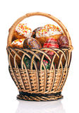 Basket with Easter cakes and painted eggs Stock Photo