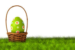 Basket for Easter Egg hunt. On grass on white background Royalty Free Stock Photo