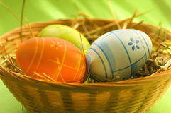 Basket with Easter eggs. Basket with colorful Easter eggs with interesting green background stock photography
