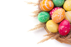 Basket with Easter eggs. Braided basket with Easter eggs  on white Stock Images