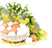 Basket with Easter eggs royalty free stock photography