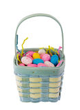 Basket of easter eggs. Wicker basket of pastel colored Easter eggs, isolated on white background Royalty Free Stock Photo