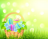 Basket with easter eggs on bokeh light effect Stock Photos