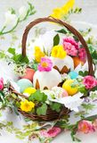 Basket with easter eggs and cake Royalty Free Stock Image