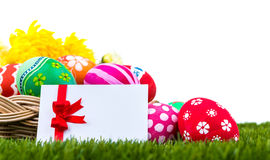 Basket of easter eggs and card on Green Grass Stock Photo
