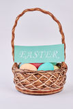 Basket, Easter eggs and card. Easter basket . He is risen Royalty Free Stock Images