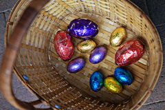 A basket of Easter Eggs. A colorful wicker basket of Easter Eggs Stock Photo