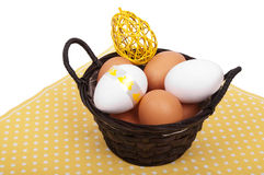 Basket with Easter eggs and decoration Stock Images