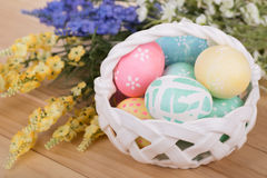 Basket of Easter Eggs with Flowers Royalty Free Stock Photo