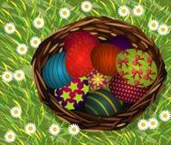 Basket of easter eggs on Fresh Green Grass Stock Photo
