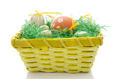 Basket with easter eggs and grass Royalty Free Stock Photo