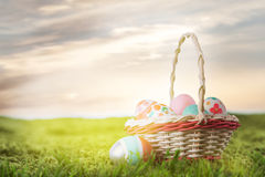 Basket with Easter eggs on the grass Stock Image