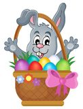 Basket with Easter eggs and happy bunny Stock Photo