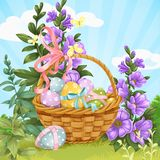Basket with Easter eggs on the lawn with herbs Stock Photography