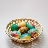The basket with Easter eggs lies on the table. There is a place for an inscription stock image