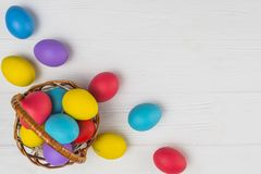 Basket with Easter eggs. colorful eggs royalty free stock photo