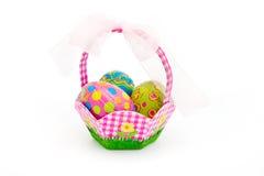 Basket of easter eggs over white Stock Photo