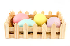Basket of easter eggs over white Royalty Free Stock Photo