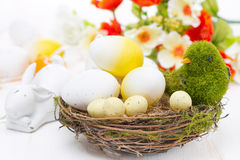 Basket with easter eggs and rabbits, close-up Stock Image