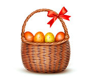 Basket with Easter eggs and a red bow. Stock Image
