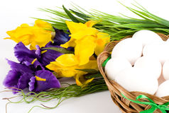 Basket with Easter eggs and spring flowers Stock Image