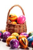 Basket of Easter eggs on table. easter decoration. Basket of Easter eggs on table. colorful easter decoration royalty free stock photo